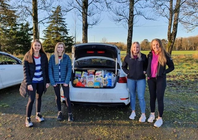 Lisnamurrican YFC members with Ahoghill YFC members Ruth Dick and Kathryn Speers donating to their local food bank