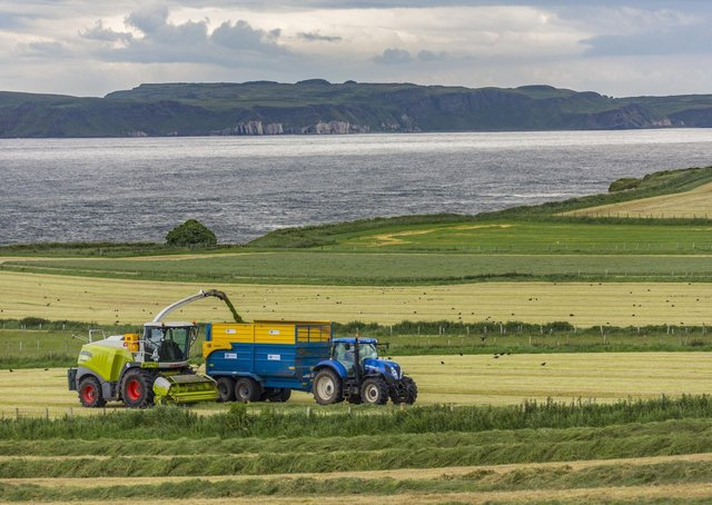 Ballycastle. Northern Ireland. 06.22.16. Agriculture - collecting silage in the fields near Ballycastle in County Antrim, Northern Ireland. Silage is grass fodder that is used as animal feed during the winter.