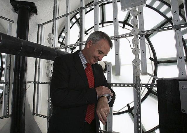 Peter McKay of Belfast City Council checks his watch inside the Albert Clock, Belfast. Picture: Gavan Caldwell/News Letter archives