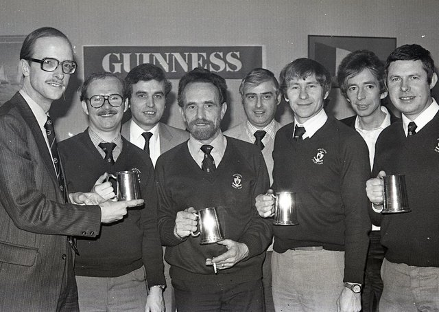 Mr John Kinahan, left, marketing manager, Arthur Guinness (Belfast) handing over trophies to the Holywood Yacht Club team which won the Guiness Inter-Pub/Club Charity Quiz, run in association with the Holywood Round Table. The team beat the Holywood Social Club in the district final. In the picture are Norman Bennett, captain, Austin Treacy, Tom Smeltzer and John Bingham. Also included are John Galbraith, scorer, Roy Williams, questionmaster, and Geoff Hunt, timekeeper. Picture: News Letter archives