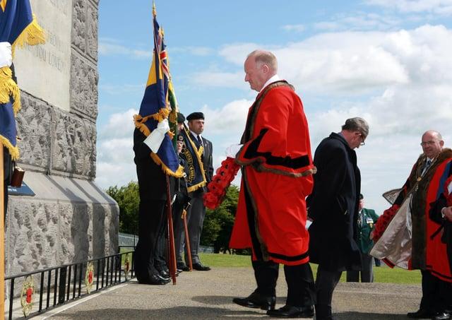 Alderman David Hilditch lays a wreath at the Co Antrim War Memorial IN 2008