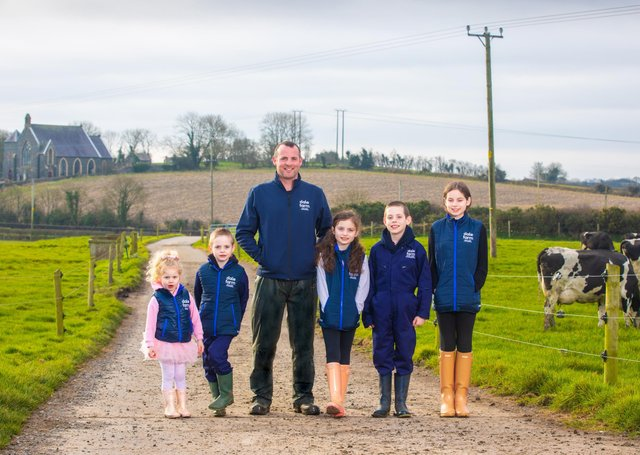 County Down Dale Farm farmer Chris Catherwood with children Lily (3), Tom (7), Molly May (8), Michael (10) and Kaitlyn (12)