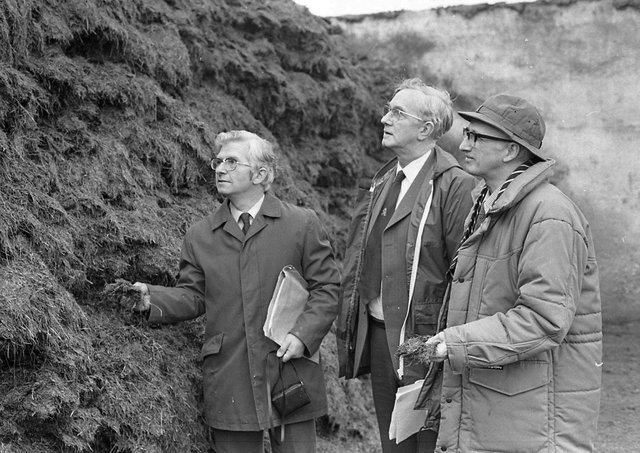 Judging of silage on the farm of Dunleath Estates, Ballywalter, Co Down, in February 1982, which was to go into the final of the British Grassland Society's UK competition. The judges were Mr Alan Kyle, the winner in 1981, Mr Ken Nelson of ICI, and Mrs Alan Edwards, East of Scotland Agricultural College. Picture: Farming Life archives