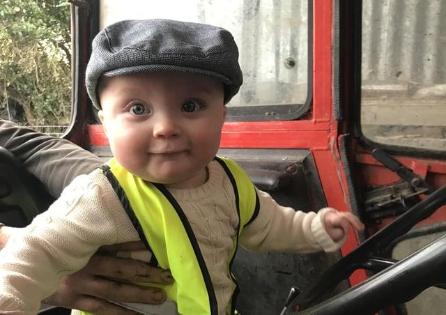 Fionn takes a seat behind the wheel.