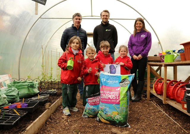 Primary 1 pupils from Friends' Prep school in Lisburn help to launch the 'Purple Potato Project' an initiative set up by Lisburn-based social enterprise Kinder Garden Cooks which has joined with organics recycling firm Natural World Products (NWP) and Patch Seed Potatoes to encourage kids to 'get growing'.  They are joined by, from left, Colm Warren of NWP, Alex McCreight of Patch Seed Potatoes and Sharon McMaster of Kinder Garden Cooks. The scheme will see 280 pupils across the Lisburn  area receive a bag of New Leaf Compost from NWP, which converts local household food and garden waste into organic, peat-free compost, and a newly-bred purple seed potato from Patch Seed Potatoes. The Purple Potato character is designed by artist Corrina Askin. Photography by Jude Rankin