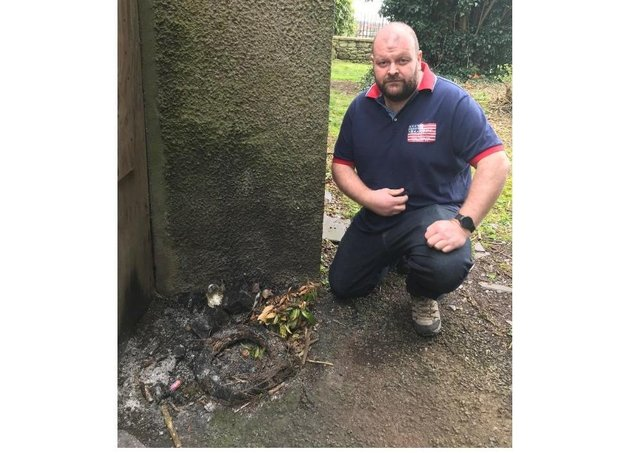 Cllr Mark Baxter were a number of wreaths were destroyed outside an NI church.