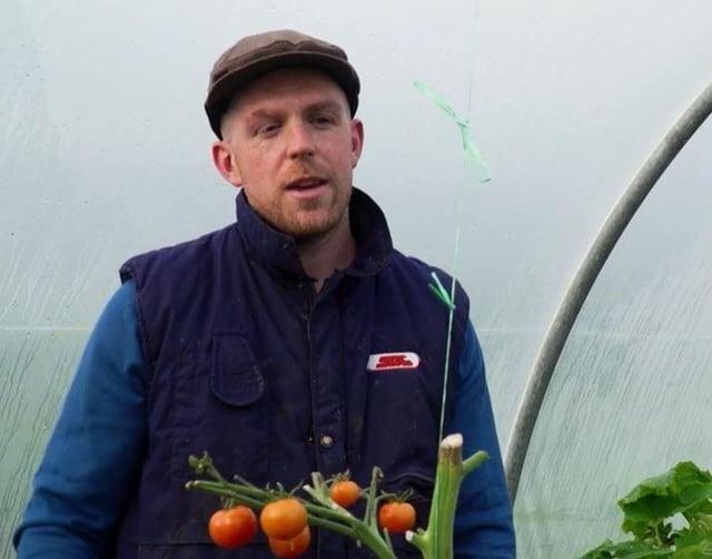 Jonny Hanson chatting about the veg box enterprise