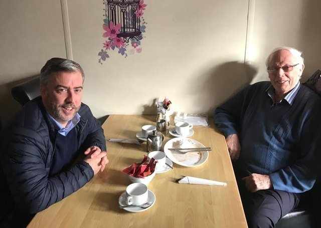 Nick Rowsome (NFU Mutual Financial Advisor) and group member Willy Potter at family Breakfast meeting.