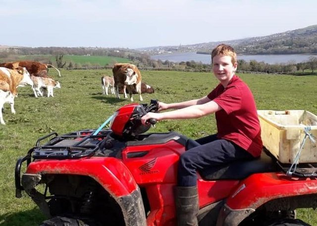 Andrew Mackey out on the quad checking the cows