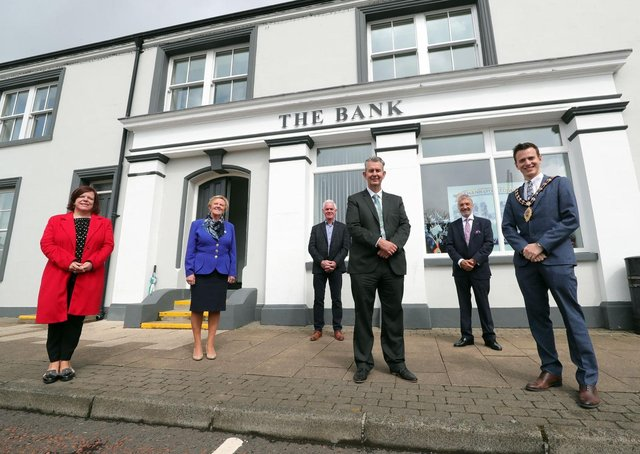 Pictured outside the old Northern Bank Building  is MEA LAG Chair, Kelli McRoberts; MEA LAG Vice Chair, Alderman Audrey Wales MBE; Portglenone Enterprise Group Director, Norman Worthington; National Lottery Heritage Fund,  Mukesh Sharma MBE; DAERA Minister, Edwin Poots and Mayor of Mid and East Antrim, Councillor Peter Johnston. The building has been converted into a community hub and office space by Portglenone Enterprise Group (PEG), which received almost £150,000 from the LEADER element of the Northern Ireland Rural Development Programme. Photo Kelvin Boyes/PressEye
