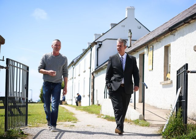 Minister Poots meets with chairman of Rathlin Development and Community Association, Michael Cecil to hear about the island's long term goal go Carbon neutral and test emerging renewable technologies on the Island. Photo by Kelvin Boyes / Press Eye