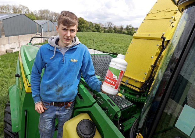 Adam Lee of Belllanaleck with the Ultra Low Volume Ecosyl silage additive applicator on a Lee Agri Contracts self propelled John Deere harvester.  An innovation that adds value to winter feed for customers and saves precious time making silage under Co Fermanagh conditions.  Using an Ultra Low Volume applicator only two litres of water are needed to treat 100 tonnes of forage compared to at least 100 litres of water with the conventional system.