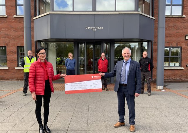 Moore Concrete managing director Wilbert Moore presents a cheque for £1448.80 to Kerry Anderson; Head of Fundraising at Air AmbulanceNorthern Ireland