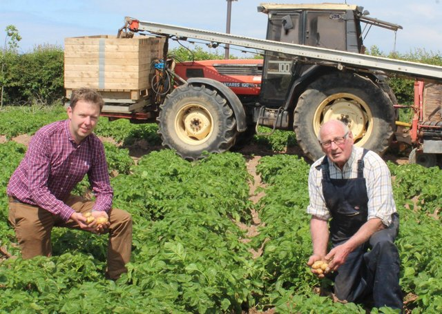 North Down potato grower Hugh Chambers (right) harvested the first of this year's Comber Earlies yesterday (Friday June 11th). He was joined by Wilson's Country agronomist Stuart Meredith. The potatoes will be in the shops on Monday next (June 14th)