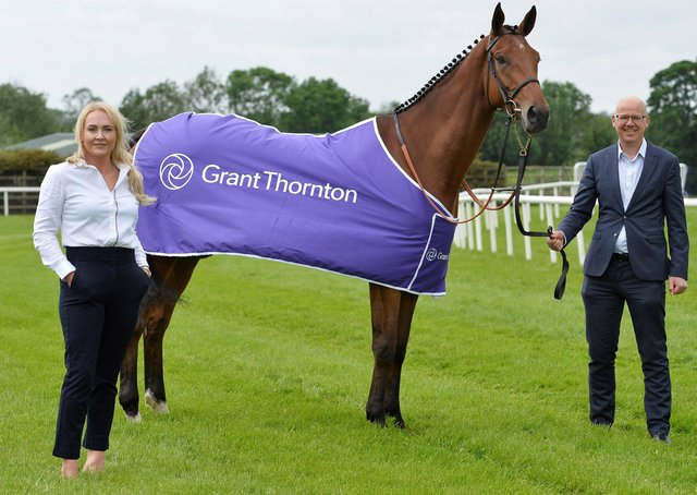 Pictured (l-r) are Emma Meehan, Chief Executive of Down Royal Racecourse and Richard Gillen, Managing Partner at Grant Thornton Northern Ireland alongside 4 year old Ballyhigh owned by Wilson Dennison.