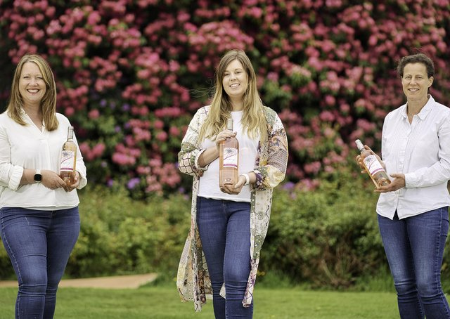 The Ode to Joy wine is helping to support Youth Action NI's Rainbow Lights project. Pictured are Joanna Sterling, Business Support Manager, Scarlett Clarke, Marketing Executive, and Averil Johnston, Buyer, JN Wine