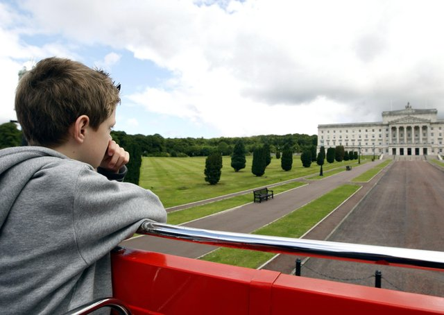 Eight year-old Joule Dallas from Co Tyrone looking at Stormont Building onboard the Belfast City Sightseeing Open Top Bus Tours in 2009. Picture: Diane Magill/News Letter archives