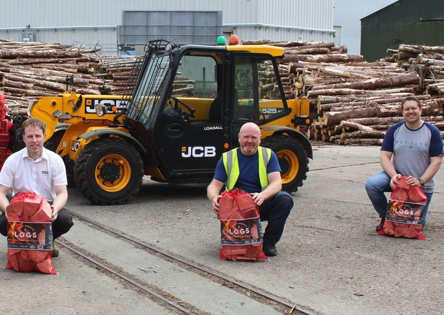 Discussing the benefits of the JCB 525-60 telehandler: l to r Jeremy Gillan, Link Logs; Jeff Haslett; Dennison JCB and Ricky Wright, CEO Vineyard Compassion