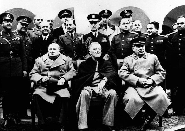 Winston Churchill (left) with Franklin D Roosevelt (centre) and Josef Stalin with their advisers at the Yalta Agreement talks February 1945. The agreement was instrumental to the partitioning of Germany and the inception of the United Nations. Picture: PA News