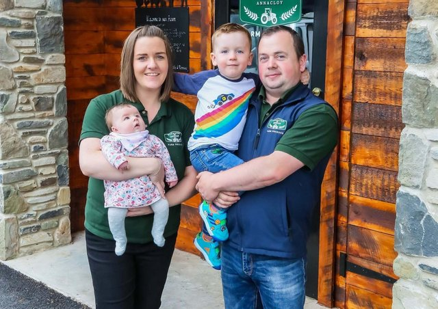 Karrane and Malachy McGrath with their son Niall and baby daughter Sarah outside their new farm shop