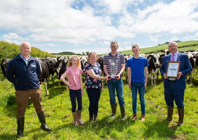 SUPREME MILK QUALITY CHAMPIONS - Cyril and Jennifer Gibson, with children Joel and Jessica, Beragh, Omagh, Co. Tyrone, Northern Ireland Supreme Champions of the Lakeland Dairies Milk Quality Awards, for the exceptionally high quality of milk they have produced on their farm throughout the past year. They were presented with the award on their farm by Lakeland Dairies' Chairman, Niall Matthews (left) and Group CEO Michael Hanley.