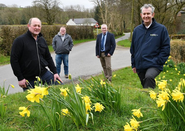 DAERA Minister Edwin Poots MLA is pictured visiting one of the impacted farms in March this year (L-R) farm owner Drew Fleming, Declan McAleer MLA and President of the Ulster Farmers' Union Victor Chestnutt.