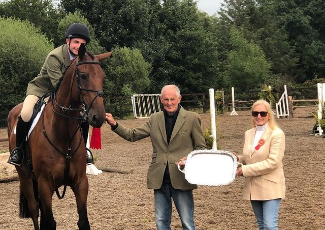 From left, Working Hunter Derby winner, Michael McGaffin on 'Green Hall Rock N Roll', David McClurg and Joan Cunningham (show director) presenting the Barbra Andrew's Memorial Tray