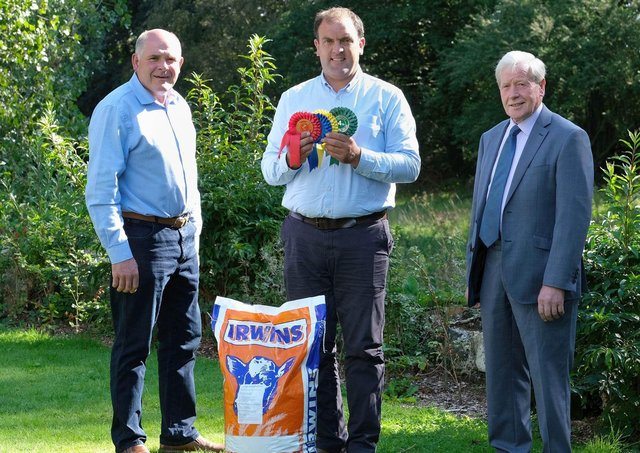 Outlining plans for the Dungannon Dairy Sale on Thursday 16th September, are sponsor Ian Cummins, Irwins Feed, with Holstein NI chairman Iain McLean, and president James Walker. Photograph: Columba O'Hare/ Newry.ie