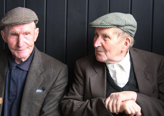 Rathkenny brothers Norman and Bertie Kerr take life easy at the Glenravel Festival Country Fair in August 2009. Pictures: John McIlwaine/Ballymena Times/Farming Life archives