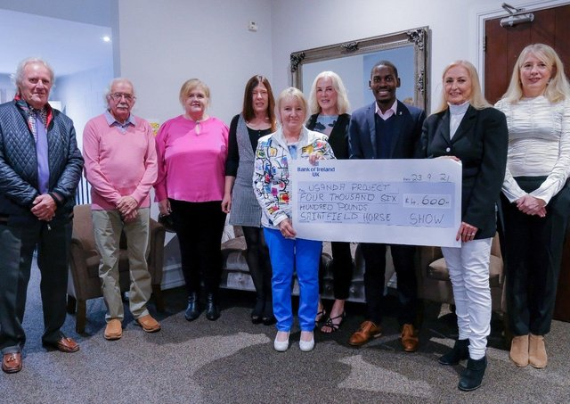 Saintfield Horse Show director Joan Cunningham and the Saintfield Horse Show team presented a cheque for £4,600 at the Temple Golf Club last Thursday evening. The money raised will go towards the Ugandan Project. From left, Derek Spencer, Robin Patterson, Elma Newberry, Mandy Price, Vi Patterson, Angela Cartright, Pius Kulama, Joan Cunningham and Iona McCreery
