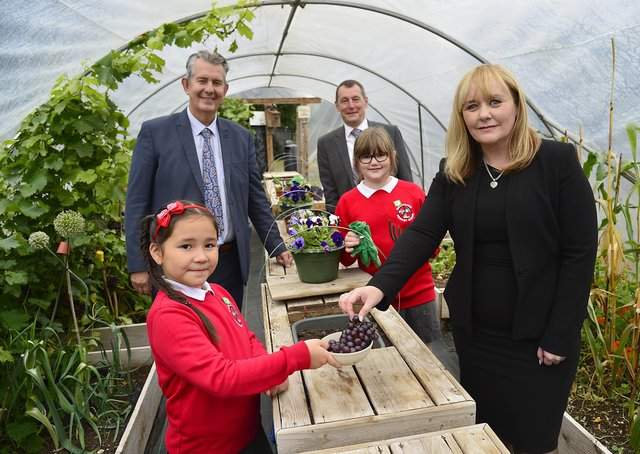Ballycraigy Primary School P6 pupils Bethany (left) and Elizabeth show Environment Minister Edwin Poots (left), Keep Northern Ireland Beautiful Chief Executive Dr Ian Humphreys and Education Minister Michelle McIlveen the work they do in their garden as part of their Eco School Programme which is funded by DAERA and delivered by KNIB.